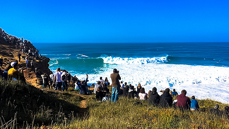 People watching the surfers